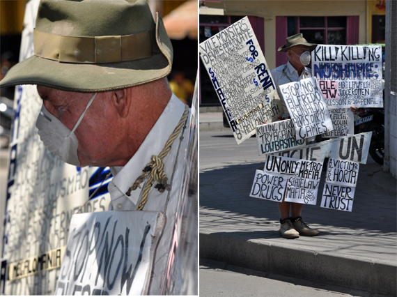 demonstran - pria berpapan di pinggir jalan