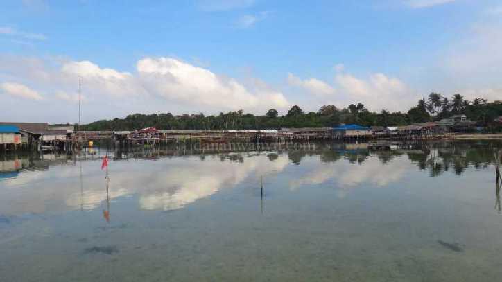 sepulang trip - mendung menghilang di desa Pulau Bakau