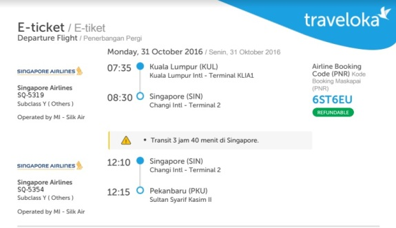 Akhirnya saya mendapatkan tiket ke Pekanbaru walau harus transit ke Singapura
