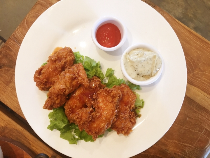 * Chipotle Chicken Tenders 70 Fried chicken tenders (Kentucky style) smothered with our house honey-chipotle sauce and served with a side of ranch